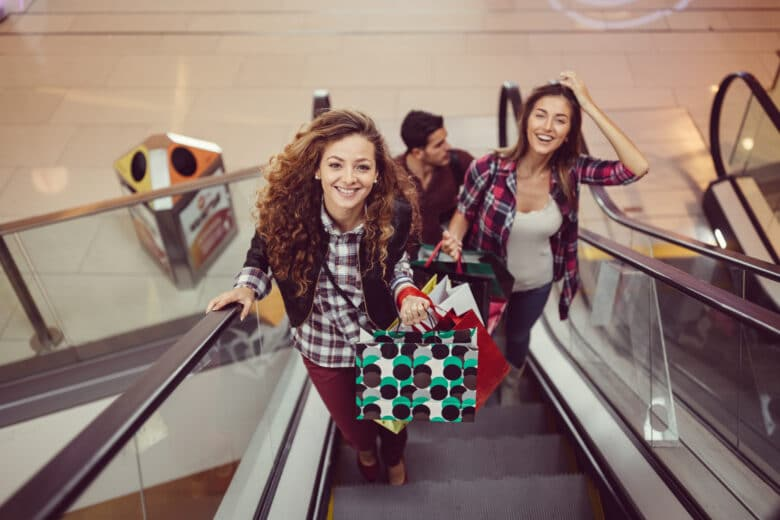Young people enjoying the day in the shopping mall